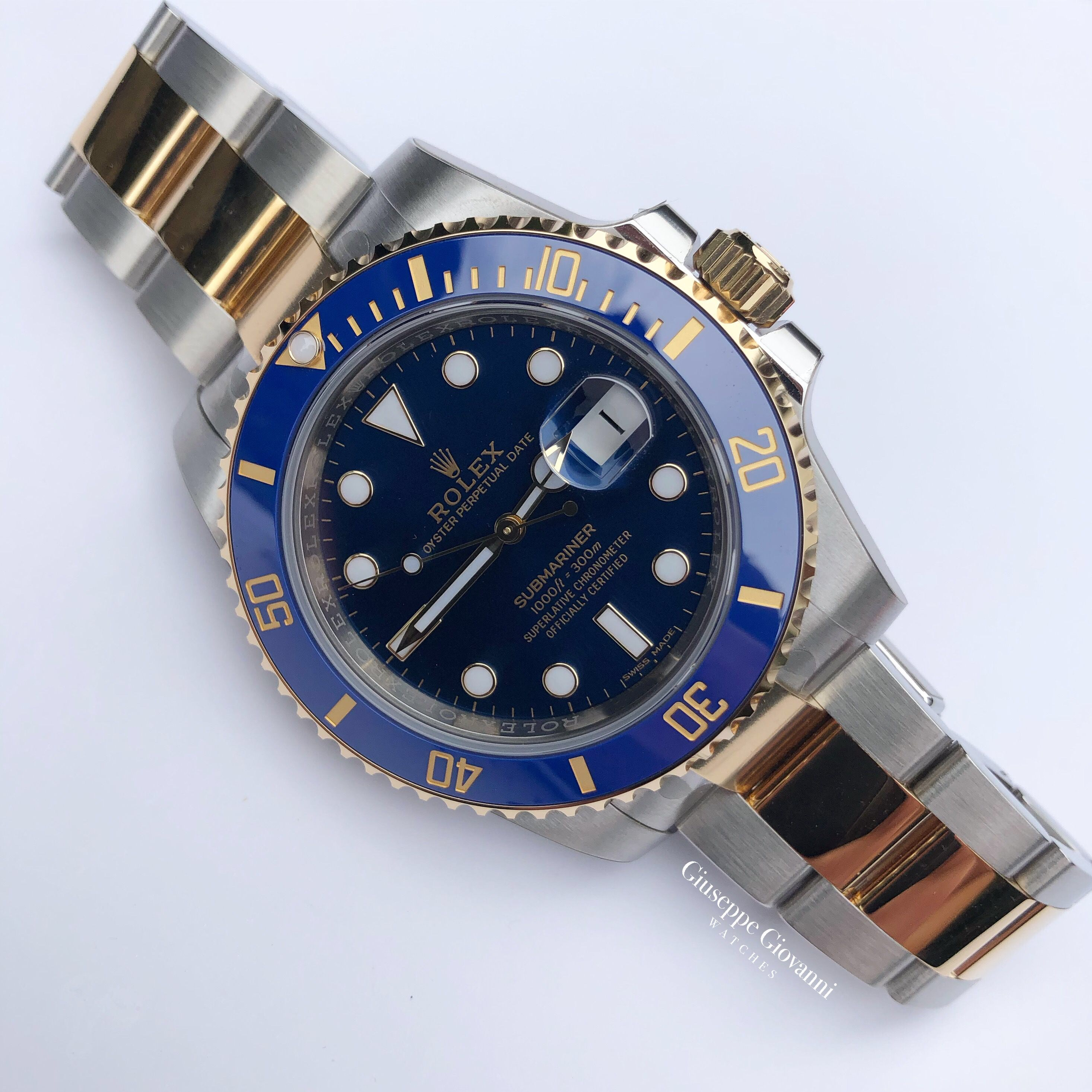25 Rolex Submariner 116613LB YellowGoldOystersteel OysterBracelet BlueDial